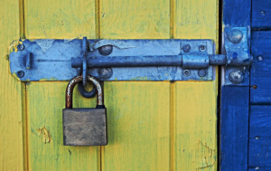 padlock attached on a gate for garage door security