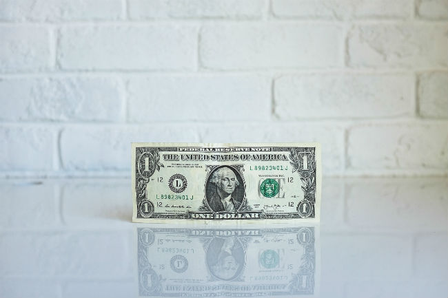 dollar on the table with white background
