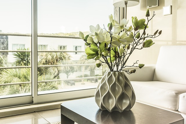 aliding windows with white table and indoorplant